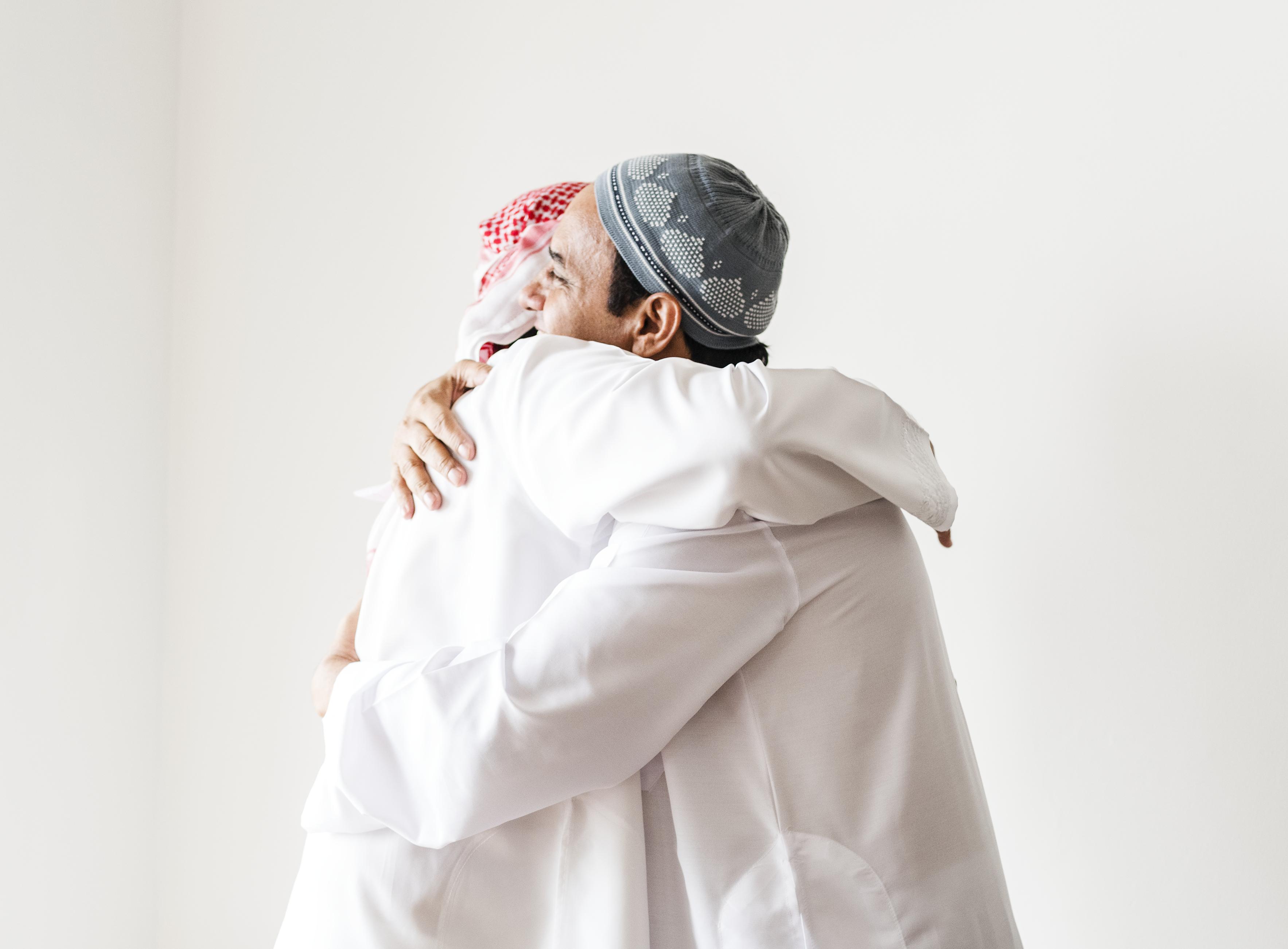 Muslim men hugging each other